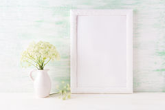 White frame mockup with delicate wild field flowers in pitcher Stock Photo