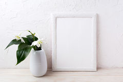 White frame mockup with euxaris flower in vase Royalty Free Stock Photography