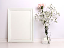 White frame mockup with flowers.