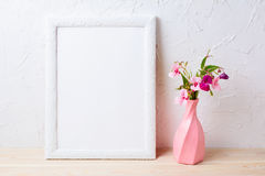 White frame mockup with flowers in swirled pink vase Royalty Free Stock Photo