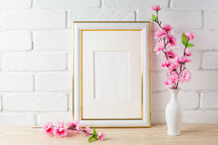 White frame mockup with pink flower bunch. Empty white frame mockup for design presentation. Portrait or poster white frame mockup romantic style royalty free stock images