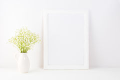 White frame mockup with Rue Anemone flowers stock photos