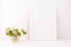 White frame mockup with Rue Anemone flowers royalty free stock photo