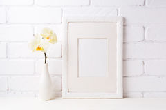 White frame mockup with soft yellow orchid in vase Stock Photo
