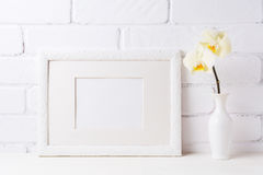 White frame mockup with soft yellow orchid in vase Royalty Free Stock Photos
