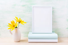 White frame mockup with two deep yellow rosinweed and books Royalty Free Stock Images