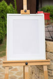 White frame mockup on a wooden stand Stock Photo