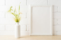 White frame mockup with yellow and green wild grass ears Royalty Free Stock Image