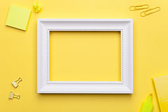 White Frame with Office Accessories on Yellow Background Stock Photos
