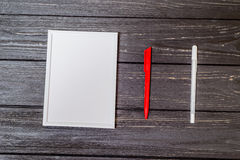 White frame with pen on wooden Royalty Free Stock Photo