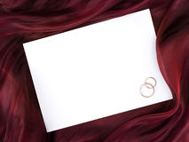 White frame in silk and two wedding rings Stock Photos