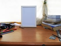 White Frame On The Study Oak Table Position 2 royalty free stock photo