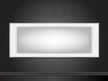 White frame on wall wallpaper. White frame on wall with seamless black wallpaper Royalty Free Stock Photos