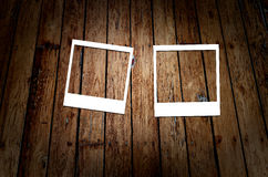 White frame on wooden grunge background Stock Photos