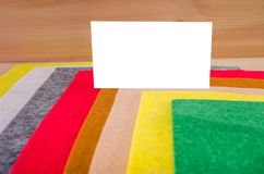 White frame for writing on a background of colored felt stock image