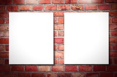 White frames on brick wall. White frames on red brick wall Royalty Free Stock Photos