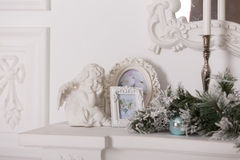 White framework for photos and a figurine of an angel Royalty Free Stock Photography