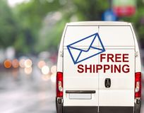 White free shipping Van driving fast on city blurr bokeh street Royalty Free Stock Image