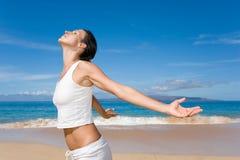 White freedom. Woman in white yoga outfit emjoys beach Royalty Free Stock Image