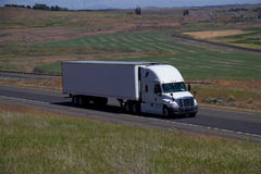 White Freightliner Semi-Truck / White Trailer Stock Image