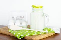 White fresh farm eggs and a pitcher of millk Royalty Free Stock Photo