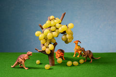 White fresh grapes and animal figures Royalty Free Stock Photography