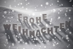 White Frohe Weihnachten Mean Merry Christmas On Snow, Snowflakes Stock Photos