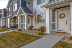 White front door of colorful townhomes with wreath stock photography