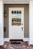 White front door with red and white brick porch Stock Image