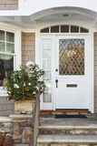 White front door of upscale beige home Royalty Free Stock Images