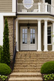 White front door with white columns Royalty Free Stock Photos