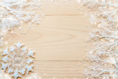 White frosty branches, covered with snow, white snowflake and copy space on horizontal unpainted wooden planks. Stock Photo