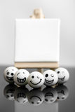 White funny marbles with business concept Royalty Free Stock Photography