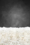 White fur carpet and dark grey painted wall Stock Photo