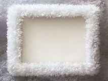 White fur winter frame background. White fur New Year frame background with empty space Royalty Free Stock Photo