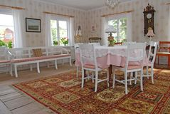 White furniture in house. A view of white furniture including tables and chairs in a large, well decorated room Stock Image