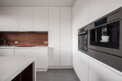 White furniture in wooden kitchen royalty free stock photos