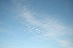 White fuzzy cloudy in blue sky diagonally Royalty Free Stock Photos