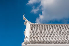 White gable apex on blue sky with cloud. Bangkok, Thailand Royalty Free Stock Photography
