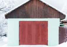 White garage closed. White garage in a private house with a brown gate closed Royalty Free Stock Image