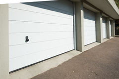 White garage doors with knob. In a entry royalty free stock photo