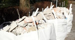 White garbage bags with rubble stones Stock Photography