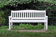 A white garden bench royalty free stock photo