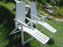White garden chairs. Two white garden chairs Royalty Free Stock Photos