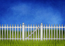 White garden fence and gate. One a green lawn Stock Images