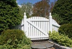 White Garden Gate. White wooden gate leading into the garden royalty free stock photos