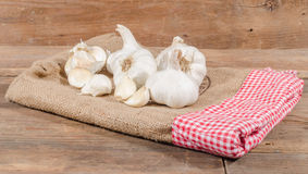 White garlic bulbs and cloves. On burlap Royalty Free Stock Photography