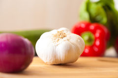 White garlic lies on a board with other vegetables Stock Photography