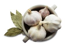 White Garlic in a Mug with Bay leaves stock photo