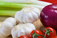 White garlic and purple onion on a wooden board Stock Images